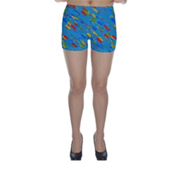 Colorful shapes on a blue background Skinny Shorts