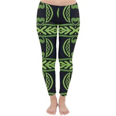 Green shapes on a black background pattern Winter Leggings