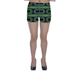 Green shapes on a black background pattern Skinny Shorts