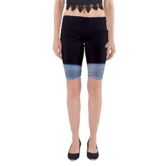 Astronaut Floating Above The Blue Planet Yoga Cropped Leggings
