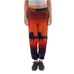 Red Sun Jet Flying Over The City Art Women s Jogger Sweatpants