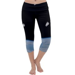 Astronaut Floating Above The Blue Planet Capri Yoga Leggings