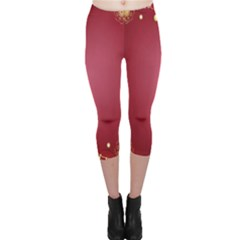Red Background With A Pattern Capri Leggings