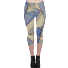Blue And Tan Triangles Intertwine Together To Create An Abstract Background Capri Leggings