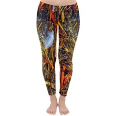 Abstract In Orange Sealife Background Abstract Of Ocean Beach Seaweed And Sand With A White Feather Classic Winter Leggings