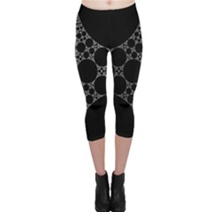 Drawing Of A White Spindle On Black Capri Leggings