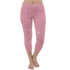 Pink background with white hearts on lines Capri Winter Leggings