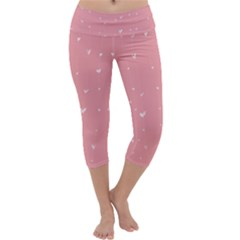 Pink background with white hearts on lines Capri Yoga Leggings