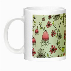Pink whimsical flowers on blue Glow in the Dark Mug