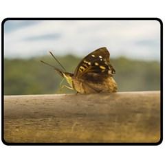 Butterfly against Blur Background at Iguazu Park Fleece Blanket (Medium)