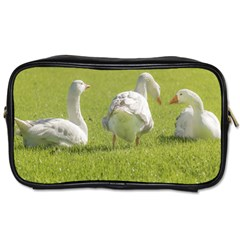 Group of White Geese Resting on the Grass Toiletries Bags