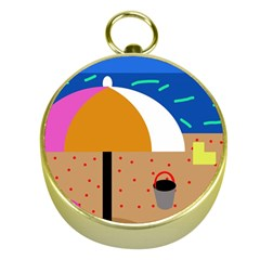 On the beach  Gold Compasses