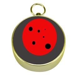 Red circle Gold Compasses
