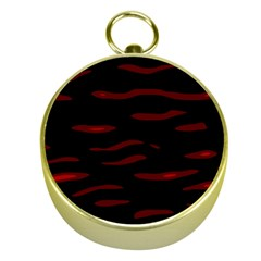 Red and black Gold Compasses