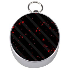 Black and red Silver Compasses