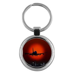 Red Sun Jet Flying Over The City Art Key Chains (round)