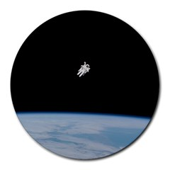 Astronaut Floating Above The Blue Planet Round Mousepads