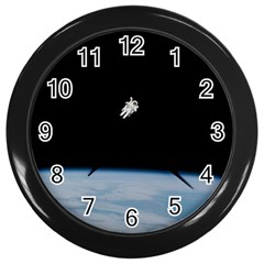 Astronaut Floating Above The Blue Planet Wall Clocks (Black)
