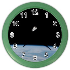 Astronaut Floating Above The Blue Planet Color Wall Clocks