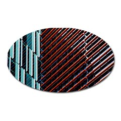 Red And Black High Rise Building Oval Magnet