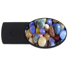 Rock Tumbler Used To Polish A Collection Of Small Colorful Pebbles USB Flash Drive Oval (2 GB)