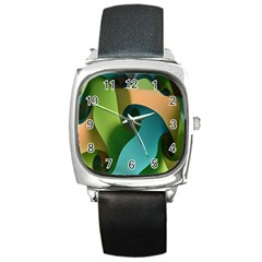 Ribbons Of Blue Aqua Green And Orange Woven Into A Curved Shape Form This Background Square Metal Watch