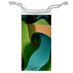 Ribbons Of Blue Aqua Green And Orange Woven Into A Curved Shape Form This Background Jewelry Bag