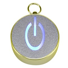 Close Up Of A Power Button Gold Compasses
