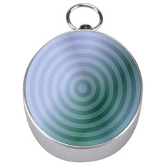 Teal Background Concentric Silver Compasses