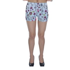 Pink Whimsical Flowers On Blue Skinny Shorts by Zandiepants