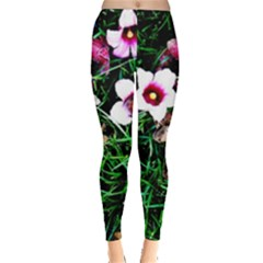 Pink Flowers Over A Green Grass Leggings  by DanaeStudio