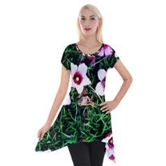 Pink Flowers Over A Green Grass Short Sleeve Side Drop Tunic by DanaeStudio