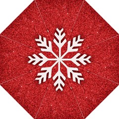 Macro Photo Of Snowflake On Red Glittery Paper Folding Umbrellas by Nexatart