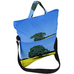 Tree In Field Fold Over Handle Tote Bag by Alisyart