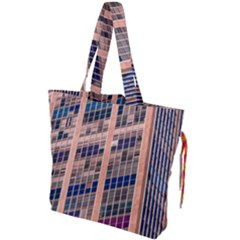 Low Angle Photography Of Beige And Blue Building Drawstring Tote Bag