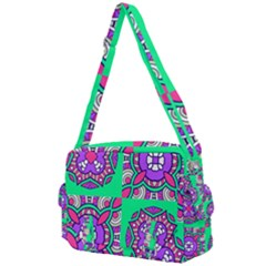 Purple Shapes On A Green Background                      Buckle Multifunction Bag by LalyLauraFLM
