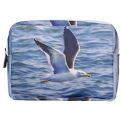 Seagull Flying Over Sea, Montevideo, Uruguay Make Up Pouch (medium) by dflcprintsclothing