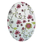 Pink whimsical flowers on blue Oval Ornament (Two Sides) Front