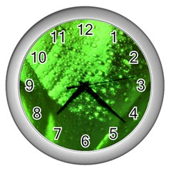 Green And Powerful Wall Clocks (silver)  by timelessartoncanvas