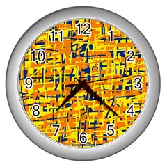 Yellow, Orange And Blue Pattern Wall Clocks (silver)  by Valentinaart
