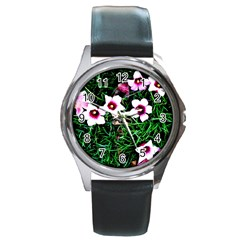 Pink Flowers Over A Green Grass Round Metal Watch by DanaeStudio