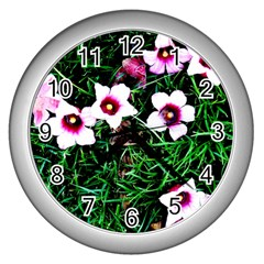 Pink Flowers Over A Green Grass Wall Clocks (silver)  by DanaeStudio