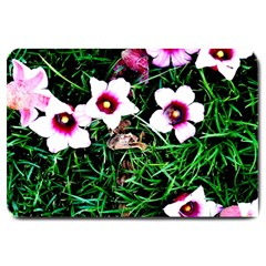 Pink Flowers Over A Green Grass Large Doormat  by DanaeStudio