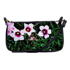 Pink Flowers Over A Green Grass Shoulder Clutch Bags by DanaeStudio