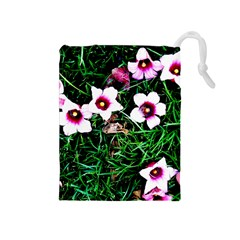 Pink Flowers Over A Green Grass Drawstring Pouches (medium)