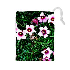 Pink Flowers Over A Green Grass Drawstring Pouches (large)  by DanaeStudio