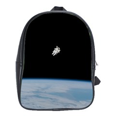 Astronaut Floating Above The Blue Planet School Bags (xl)  by Nexatart