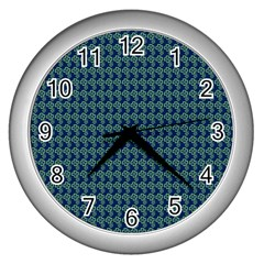 Clovers On Dark Blue Wall Clocks (silver)  by PhotoNOLA