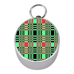 Bright Christmas Abstract Background Christmas Colors Of Red Green And Black Make Up This Abstract Mini Silver Compasses by Simbadda