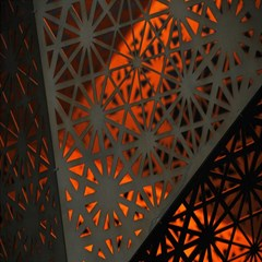 Abstract Lighted Wallpaper Of A Metal Starburst Grid With Orange Back Lighting Magic Photo Cubes by Nexatart